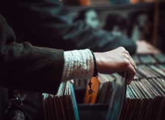 Hand searching through bins of records